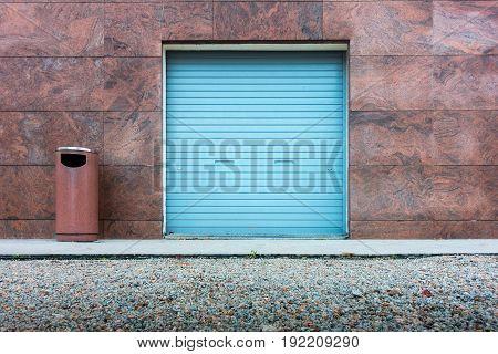 Roller shutter door and wall granite background., Outdoor
