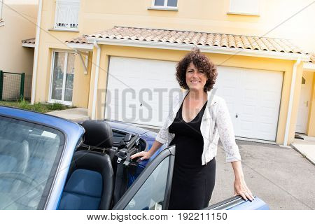 At Home Curly Woman With Convertible Car Go To Work