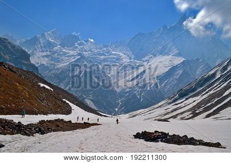 Hikers in Himalayan mountains. Nepal, Annapurna region, Annapurna Base Camp track. View of Machapuchare peak. Travel concept.