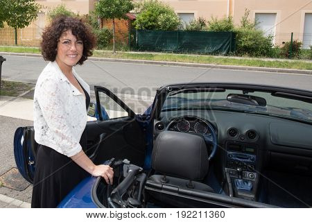 Beautiful Woman With Convertible Car In Summer Street Town