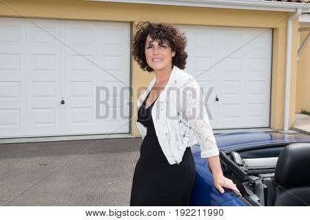 Girl In Front Of Garage House With Car In Summer