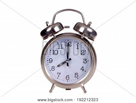 Old fashioned style alarm clock set to 8 o'clock. 8 AM is a common start time for grade school children and work for adults. Eight PM is a common bedtime for kids. Time concept. Isolated on white.