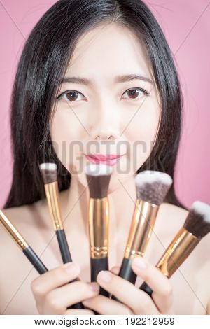 Long Hair Asian Young Beautiful Woman Smile And Fun, Touch Her Face And Hold Cosmetic Powder Brush S