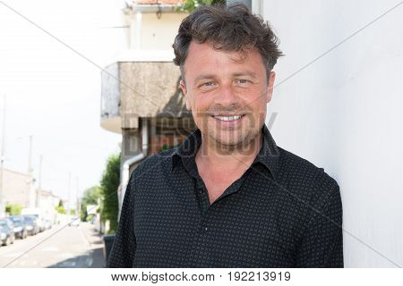 Handsome Forties Man Outdoor In Summer With Blue Eyes And Black Shirt