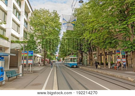 Zurich Shopping Street Bahnhofstrasse With Tram And Flag