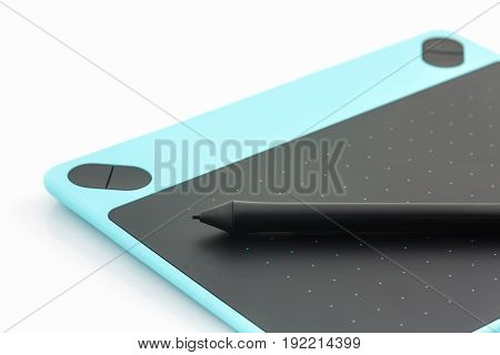 Digital graphic tablet and pen isolated on white background.