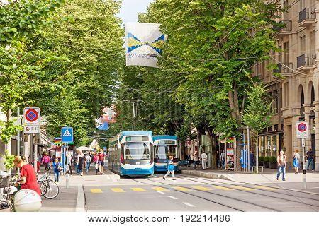 Zurich Shopping Street Bahnhofstrasse With Tram And Flag