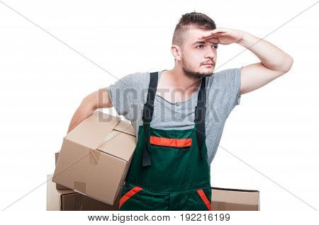 Mover Guy Holding Cardboard Box Looking Far Away