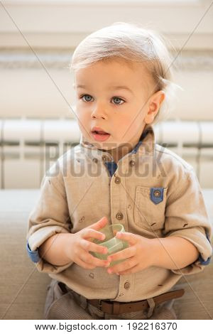 Portrait Of Nicely Dressed Little Boy With Blue Eyes.