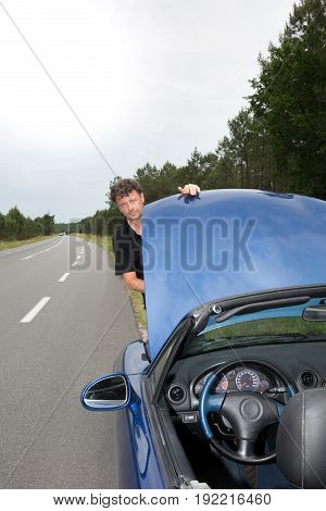 Man With Break Down Car On Road With Failure