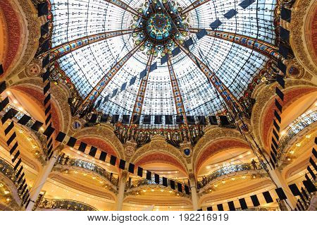 Paris France - May 30 2017: Inside part of the famous Galeries Lafayette with it's brand stands Hermes Chanel and Givenchy in Paris France