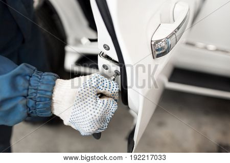 locksmith car will repair white car door , selective focus to screwdriver - can use to display or montage product or make a website for service