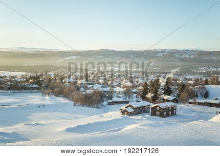 A Beautiful Morning Panorama Of A Small Norwegian Town During Sunrise With A Flares And Warm Look