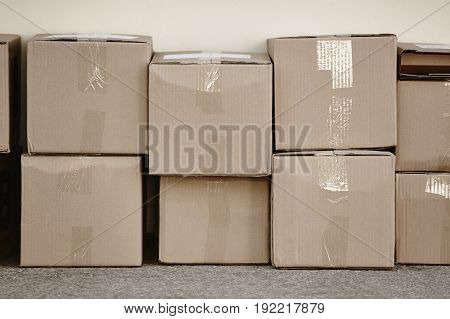 Stacked cardboard boxes. Delivery background. Copy space. Horizontal
