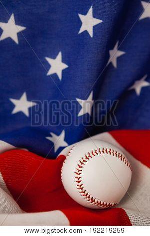 Close-up of baseball ball on American flag
