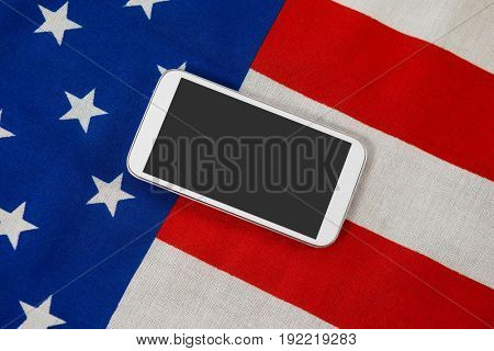 Close-up of digital tablet on American flag