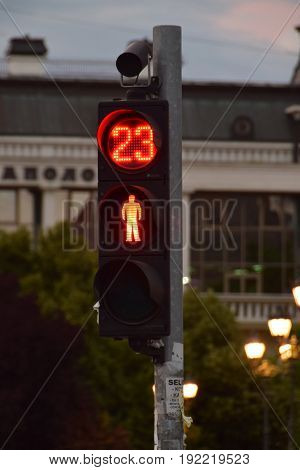 In 23 seconds you can cross the street - A red traffic light and a signal light indicating when it will turn on green