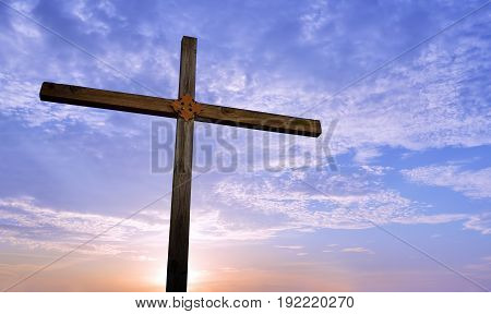 Wooden cross at sunrise or sunset concept of religion