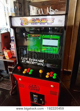 CHIANG RAI THAILAND - JUNE 1 : red vintage arcade machine with two joysticks and push buttons in a room on June 1 2017 in Chiang rai Thailand. Vertical photo