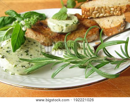 Steak with homemade herbs butter with basil and rosemary