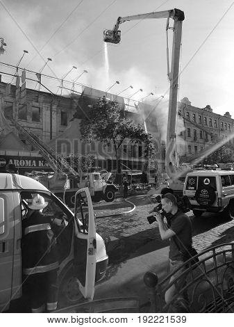 KIEV - UKRAINE - JUNE 2017:  Fire in historic building at Kreschatik Street at city center. Fireman, poliece, Firefighters extinguish a fire near famous TSUM department store. 20-th of June