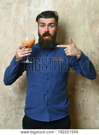 Brutal Hipster Holding Tropical Alcoholic Fresh Cocktail
