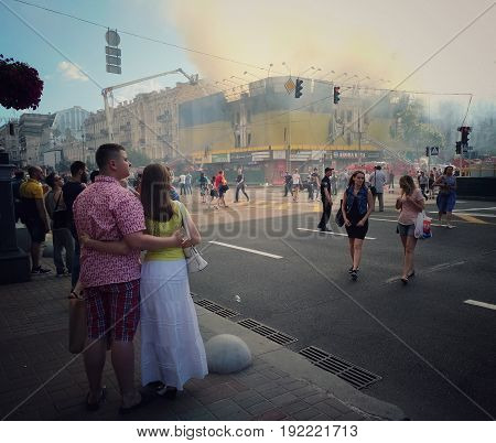KIEV - UKRAINE - JUNE 2017:  Fire in historic building at Kreschatik Street at city center. Fireman, poliece, Firefighters extinguish a fire near famous TSUM department store. 20-th of June. Passers-by