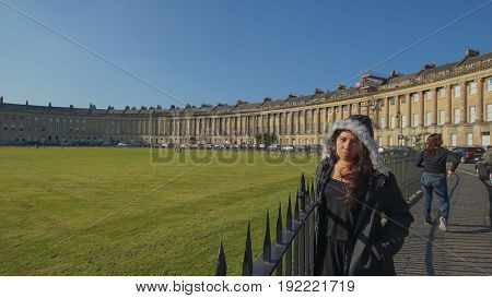 woman enjoys good green view and weather at royal crescent in bath city in united kingdom Europe/ woman at royal crescent