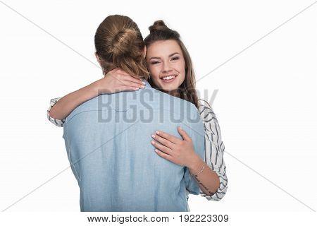 Back View Of Young Man Hugging Beautiful Girl Smiling At Camera