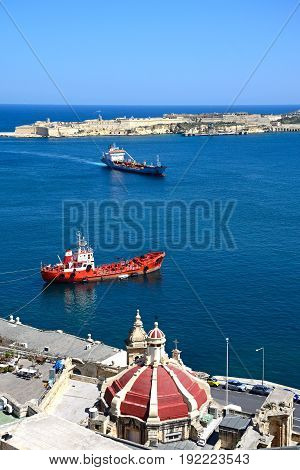 VALLETTA, MALTA - MARCH 30, 2017 - Elevated view of the grand harbour with fort to the rear and a church dome in the foreground Valletta Malta Europe, March 30, 2017.