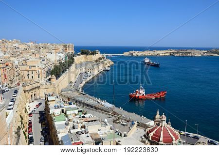 VALLETTA, MALTA - MARCH 30, 2017 - Elevated view of city buildings on the East side of the grand harbour with the bridge and fort to the rear Valletta Malta Europe, March 30, 2017.