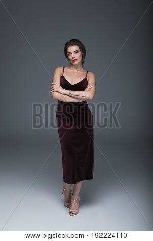 Beautiful Caucasian Woman In Evening Dress Looking At Camera With Arms Crossed