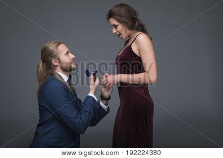 Young Man In Tuxedo Making Marriage Proposal To His Girlfriend