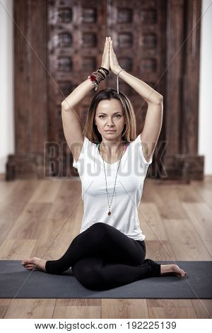 Woman Yoga practitioner in gomukhasana (cow face) pose