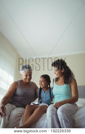 Happy family having fun on bed in bed room at home