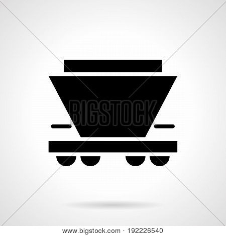 Abstract monochrome symbol of hopper rail car. Railroad transportation of bulk freights. Symbolic black glyph style vector icon.