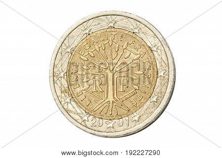 French coin of two euro closeup with tree symbol with the motto Liberte Egalite Fraternite of France. Isolated on white studio background.