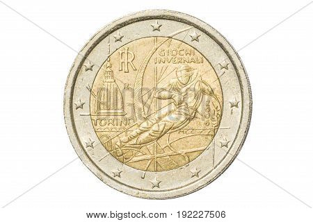 Italian coin of two euro closeup with commemorative issue symbol of Torino Olympics in Turin, Italy. Isolated on white studio background.