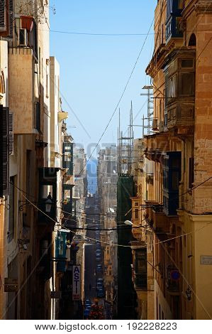 VALLETTA, MALTA - MARCH 30, 2017 - Elevated view of a city centre street Valletta Malta Europe, March 30, 2017.