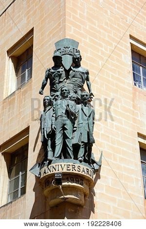 VALLETTA, MALTA - MARCH 30, 2017 - Workers memorial statue on Workers Memorial building along South Street Valletta Malta Europe, March 30, 2017.