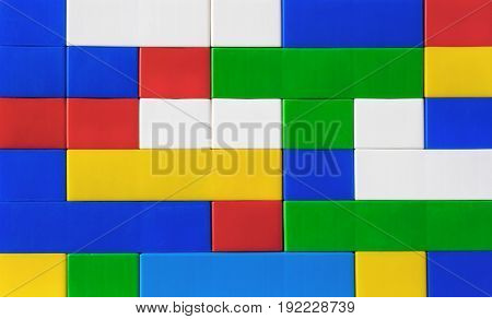 Fragment of children's colored plastic construction kit.Close-up.