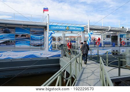 SAINT PETERSBURG RUSSIA - MAY 1 2017: Unknown tourists go to Senate quay to ticket offices to purchase tickets for river cruise on Neva St. Petersburg Russia