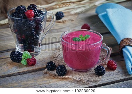 Delicious blackberry and raspberry smoothie detox yogurt or milkshake with fresh berries. Homemade organic refreshing cocktail for breakfast. Healthy food concept.