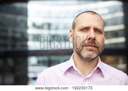 Mature Businessman In Front Of His Office