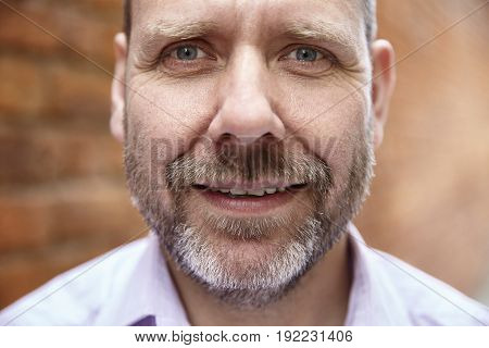 Close Up Portrait Of A Man With Beard