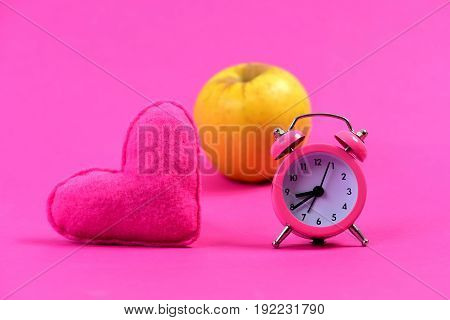 Composition Of Alarm Clock, Heart And Apple