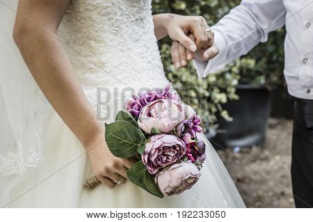 Bridal Bouquet, Bride Holding Bridal Bouquet and hand of the Groom