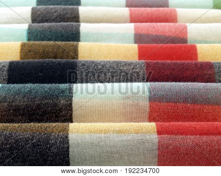 close-up wave of colorful fabric texture, pattern stripe of pastel tone cloth abstract background, selective focus