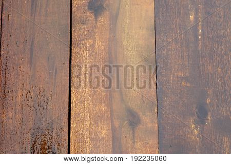 Board wooden natural planed wet after the rain. Background of wood brown. The texture of the wet wood.