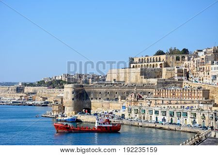 VALLETTA, MALTA - MARCH 30, 2017 - Oil tanker in the Grand Harbour with the Saluting Battery and Upper Barrakka gardens at the top Valletta Malta Europe, March 30, 2017.